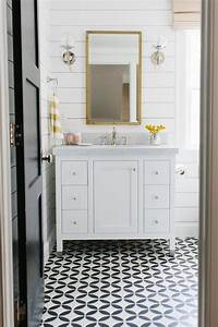 White bathroom with yellow accents transitional