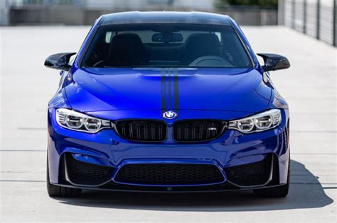 bmw m4 looks great in san marino blue with m performance parts