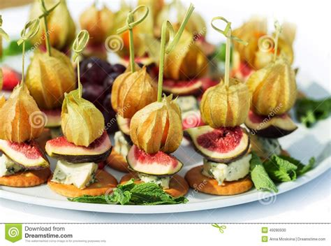 berry canapes canapes with physalis fig cheese crackers stock photo