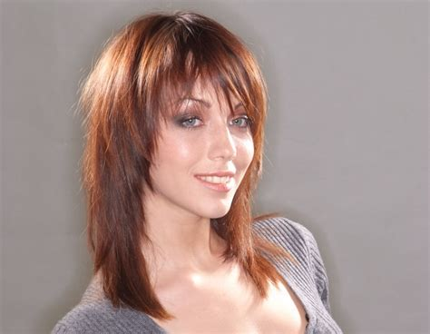 tapered hairstyles for long hair long haircut with tapering and texture that frames the face