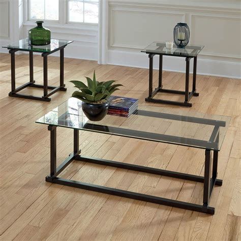 This set of three coffee/end tables have a combination of a gray powder coated metal frame and. Pin by Monique Lewis on living room | Coffee table, 3 ...