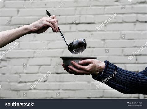 homeless hands one man metal plate stock photo 541354603
