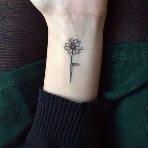 small flower tattoo  wrist  tattoo design ideas