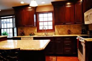 kitchen backsplash cherry cabinets venetian gold granite cherry cabinets kitchen cherries islands and the window