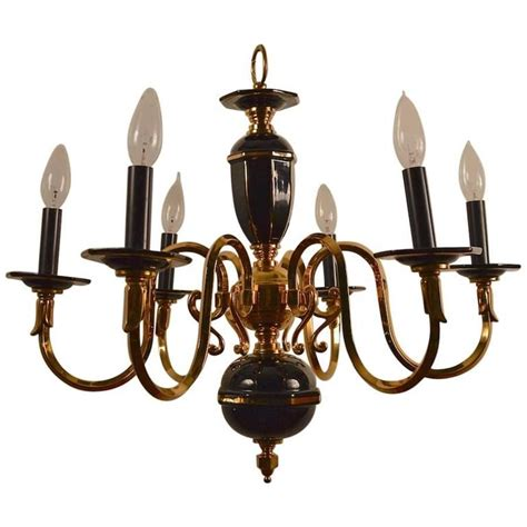 six light candle style black and brass chandelier for sale