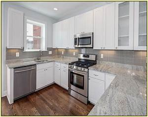 white kitchen cabinets with gray granite countertops 889