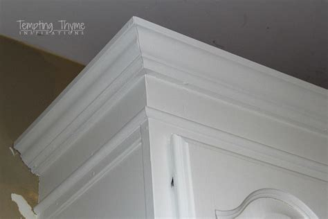 adding crown molding to kitchen cabinets adding height to the kitchen cabinets tempting thyme 9004