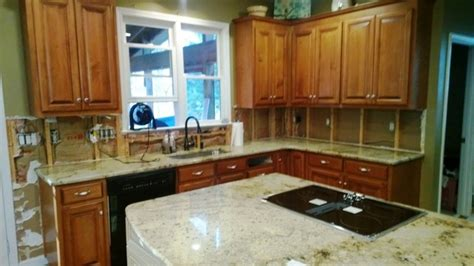 kitchen cabinet decor beige granite on medium colored wood cabinets 4 9 6688