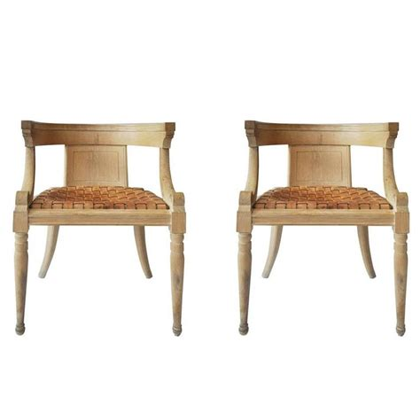 two dogwood dining chairs with saddle leather seats for