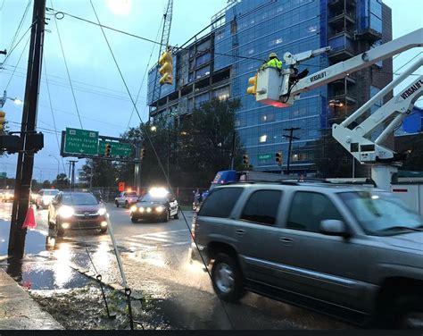 crews put   traffic light  downtown charleston