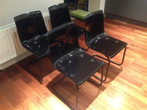 4 x ikea tobias chairs and 11msq black glass table for