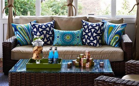 Brown Wicker Sofa With Blue And Green Trina Turk Pillows Home Decor Stores In Jacksonville Fl Handmade Decoration Items Unique Gifts Cowhide Hgtv Decorating New England Style Green Decorations For Coolest