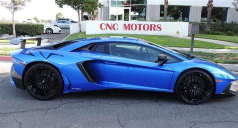 bright blue lamborghini aventador sv hits  market