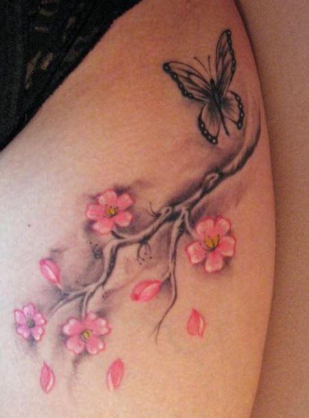 tatuaggio ramo fiori di ciliegio tatuaggio fiori di ciliegio con farfalla fotot the house