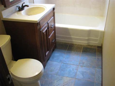 neal bathroom w slate tile floor and onyx tub shower