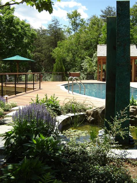 ground pool ideas pool traditional  boulders