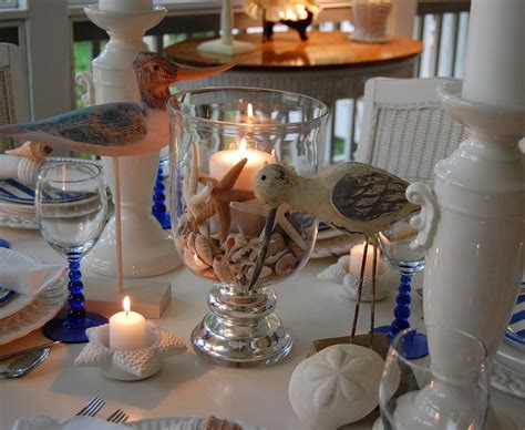 Beach Themed Table Setting with Crab Plates, Shell Centerpiece and Shell Napkin Rings