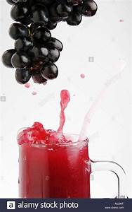 Fruit black grapes juicy healthy with glass mug of grape ...