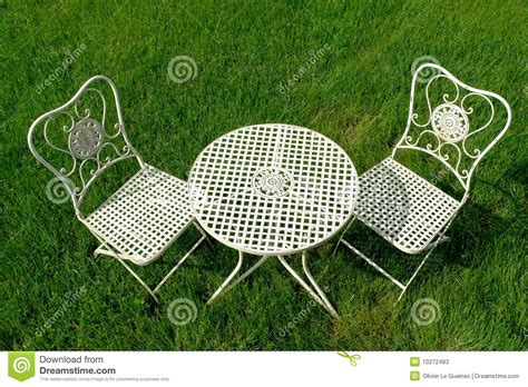 cast iron patio furniture set on green grass stock photos