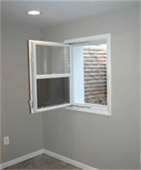 egress windows compact single hung  swing windows  redi exit