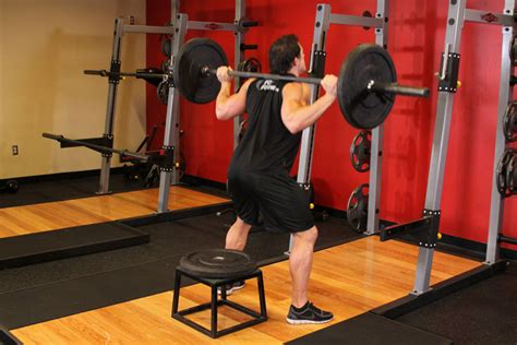 Barbell Squat To A Bench Exercise Guide And Video