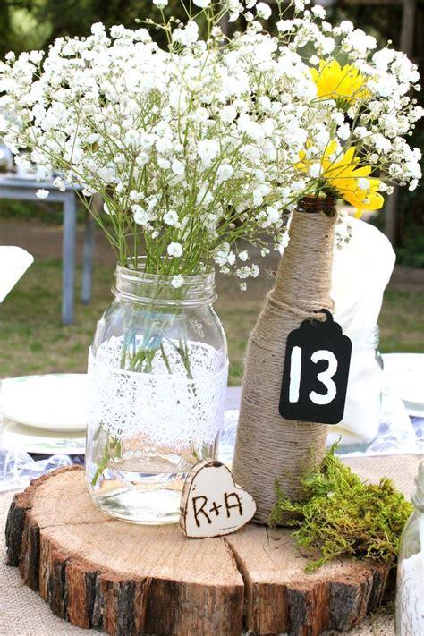Wedding Idea Baby's breath in blue mason jars is a cute
