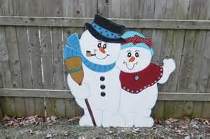 outdoor snowman wood yard by chartinisyardart