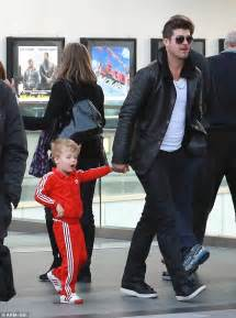 robin thickes son julian rocks red adidas tracksuit