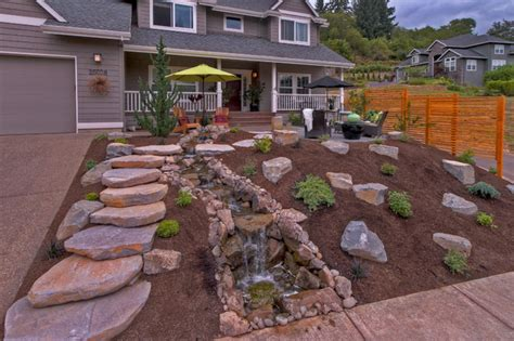 gravel landscaping gravel courtyad water fall slab stone steps privacy screens traditional landscape