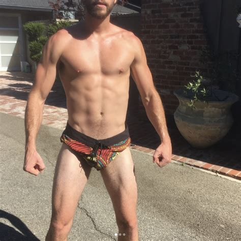 Liam Hemsworth Flexes in Tiny Shorts, Cools Off in an Ice