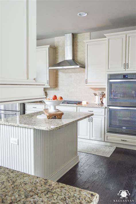 white kitchen  dark hardwood floors stainless steel