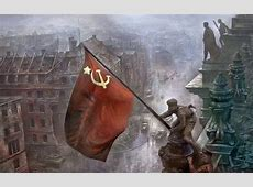Soldiers raising the Soviet flag over the Reichstag