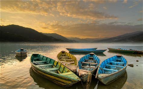 Rowboat Definition by Colored Rowboats On A Lake At Sundown Hd Wallpapers
