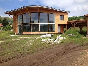 Conception d'une maison bioclimatique en ossature bois et toiture zinc ECO ARCHITECTE