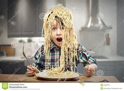 Startled Yound Boy With Noodles Stock Photo   Image: 54583716