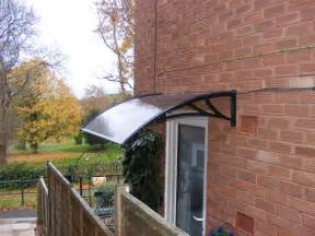 Vinyl Roll Up Patio Shades by Pc1200 Series Door Canopy