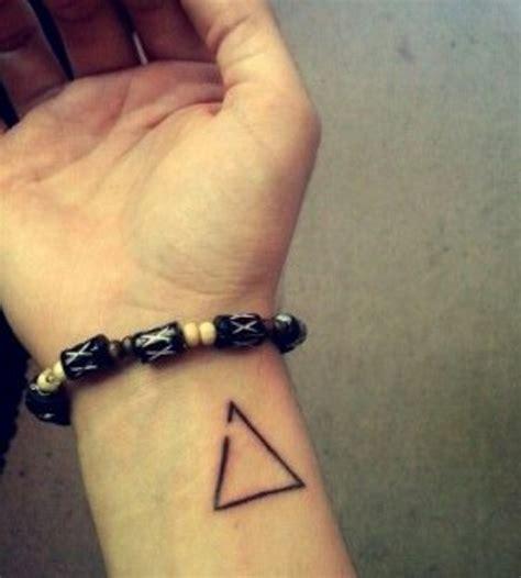 magnificent triangle wrist tattoos