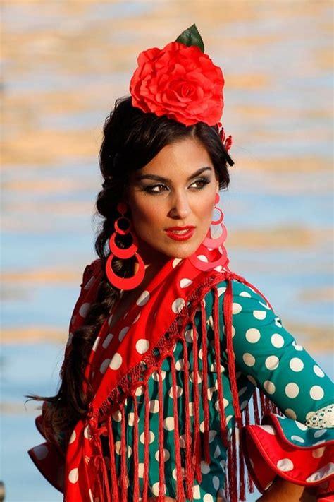 flamenco andalusia spanish spain dancers woman gypsy dress gitana culture traditional dresses shawls hair mujer sevillana vestida passion andalucia beauty