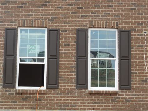 shutter colors for brown brick house close up of the