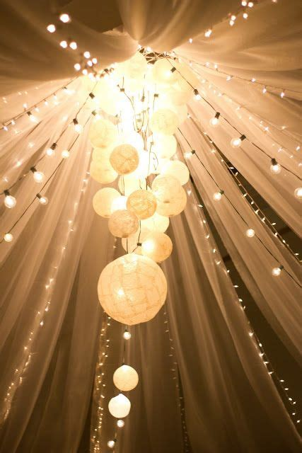 ivory tulle  lights  feet reception decoration