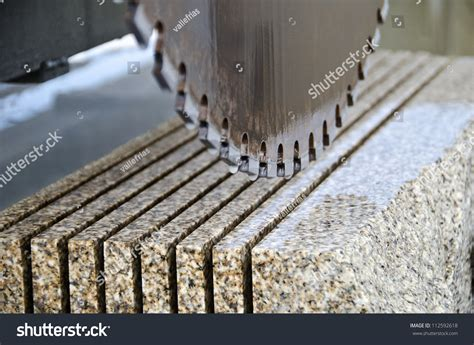 detail of a circular saw used to cut granite stock photo