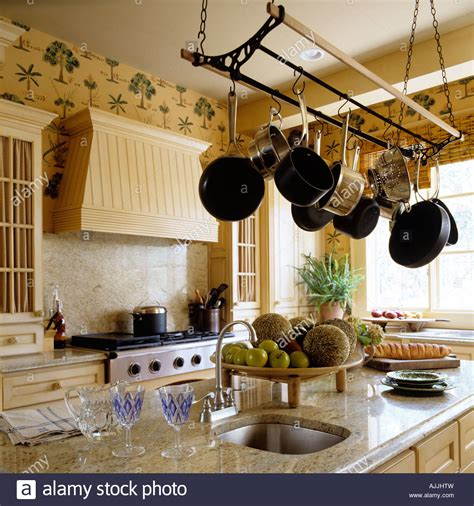 Kitchen Pulley by Kitchen With Marble Top Surface And Saucepans Hung From