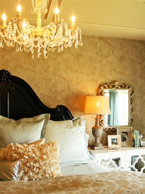 luxurious master bedroom  stately chandelier hgtv