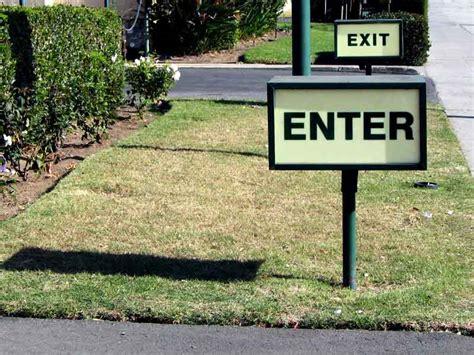exit light enter enter exit signs by cincinnati custom signs cincinnati