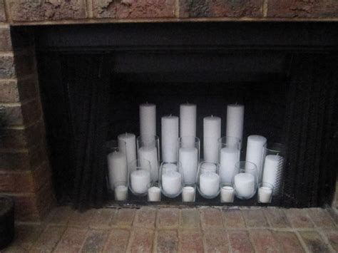 candles inside fireplace raising them up right candle filled fireplace