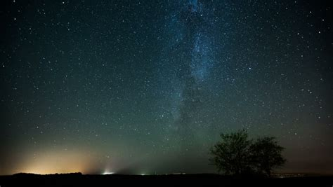 Time Lapse Of Stars Moving In Night Sky Over The Tree