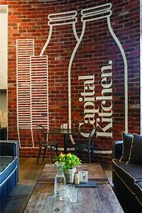 logo on brick wall of Clean and Modern Cafe with Home