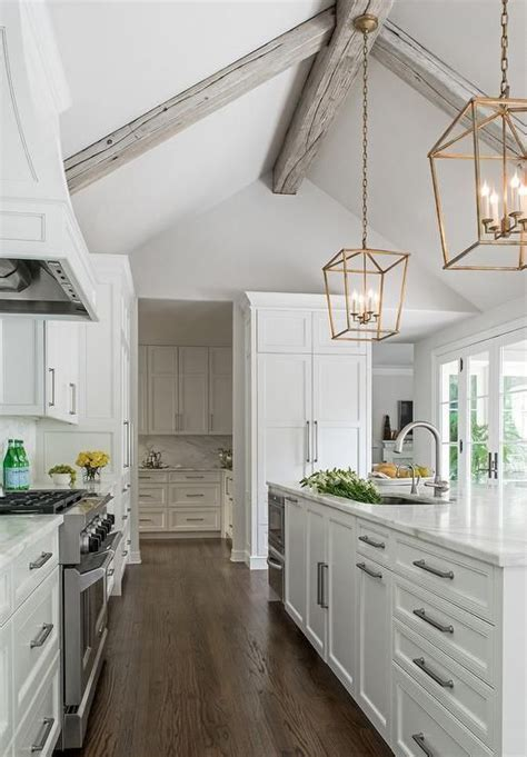 hang kitchen cabinets chic kitchen boasts a gray vaulted ceiling adorned with 1557