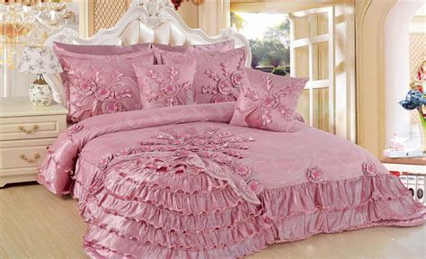 soft pink bedding set on the white wooden bed combined