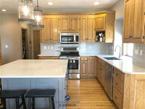golden oak kitchen cabinets with white quartz countertop subway tile sherwin williams mindful